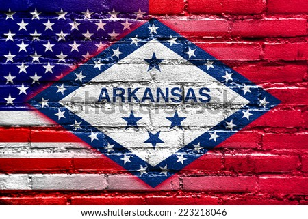 USA and Arkansas State Flag painted on brick wall - stock photo