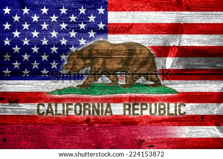 USA and California State Flag painted on old wood plank texture - stock photo