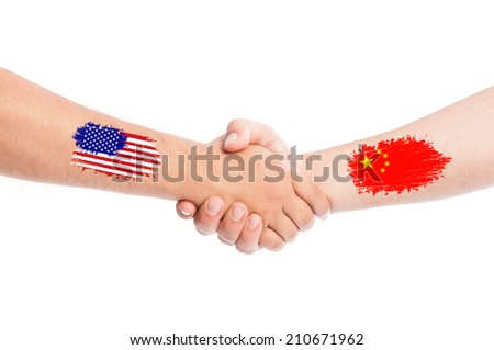 USA and China hands shaking with flags painted on arms concept. Isolated on white background. - stock photo