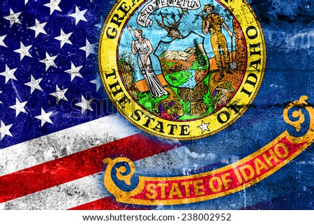 USA and Idaho State Flag painted on grunge wall - stock photo
