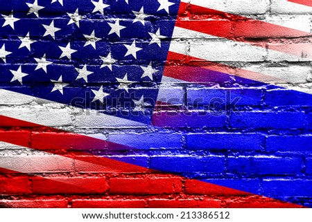 USA and Russia Flag painted on brick wall - stock photo