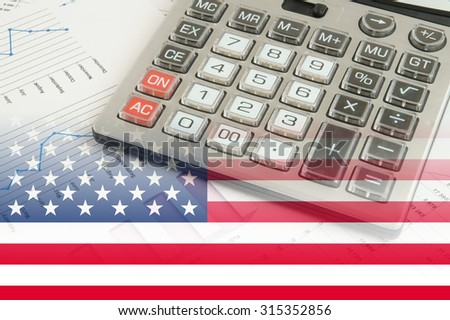 usa business concept, calculator on financial charts and graphs