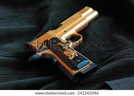 USA, CA, LOS ANGELES - 05 JANUARY 2015 - The weapon of choice for Castor Troy (Nicolas Cage / The Action Movie Face/Off) are two gold plated Springfield Armory M1911. Replica by Airsoft Surgeon - stock photo