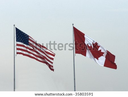 usa canadian flags - stock photo