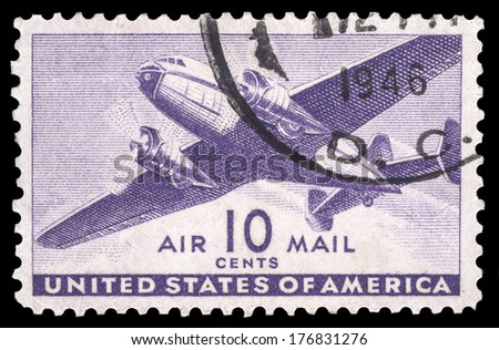 USA-CIRCA 1941: A 10 cent United States Airmail postage stamp shows image of a twin-engined transport plane, circa 1941. - stock photo