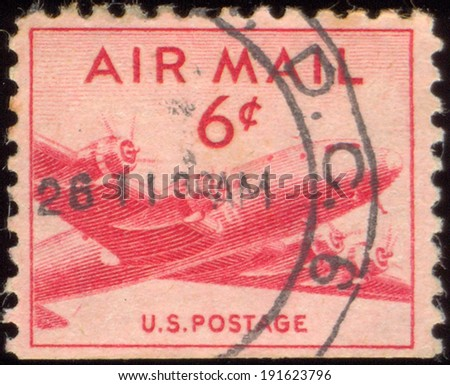 USA-CIRCA 1949: A 15 cent United States Airmail postage stamp shows image of DC-4 Skymaster transport plane, circa 1949. - stock photo