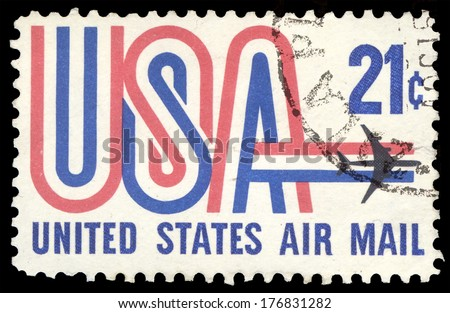 USA-CIRCA 1971: A 21 cent United States Airmail postage stamp shows image of Jet and text USA in red white and blue, circa 1971. - stock photo