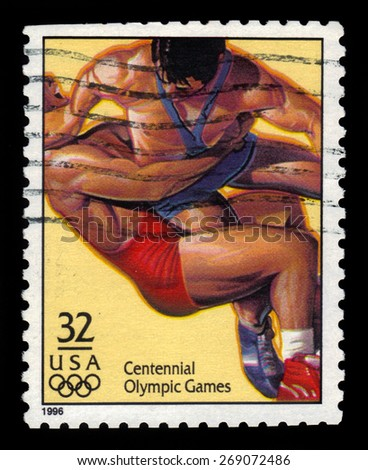 USA - CIRCA 1996: A stamp printed in the United States shows wrestling dedicated to centennial olympic games, circa 1996. - stock photo