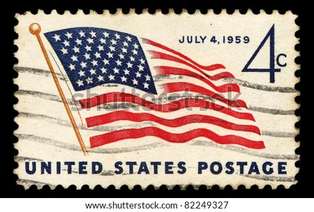 USA - CIRCA 1959 : A stamp printed in the USA shows American Flag, July 4, 1959, circa 1959 - stock photo