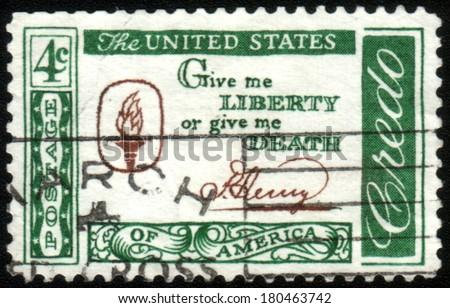 USA - CIRCA 1960 : A stamp printed in the USA shows Credo,Give me liberty or give me death,circa 1960 - stock photo