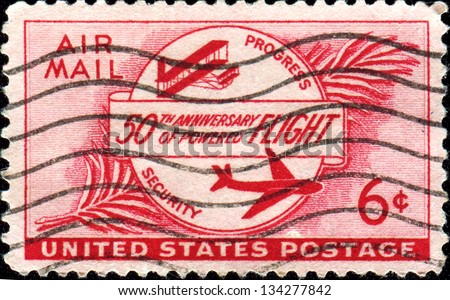 USA - CIRCA 1953: A stamp printed in United States of America celebrated the 50th anniversary of powered flight, which had been made possible by the Wright brothers�¢?? historic flight at Kitty Hawk - stock photo