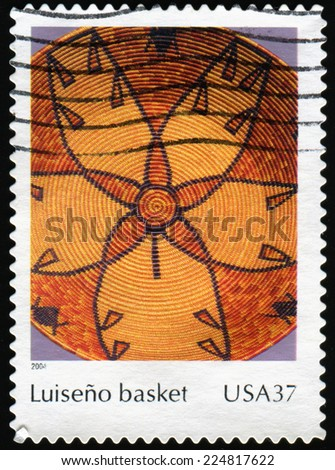 USA - CIRCA 2004: a stamp printed in United states shows American Indian Luiseno Basket  featuring a large flower motif - USA, circa 2004 - stock photo