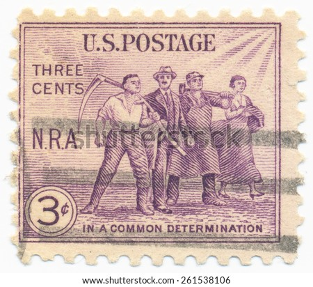 USA - CIRCA 1933: A stamp printed in United States shows Group of Workers, devoted the National Recovery Act of 1933, circa 1933 - stock photo