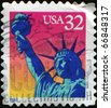 USA - CIRCA 1997: A stamp printed in US shows image of Statue of Liberty,series, circa 1997 - stock photo