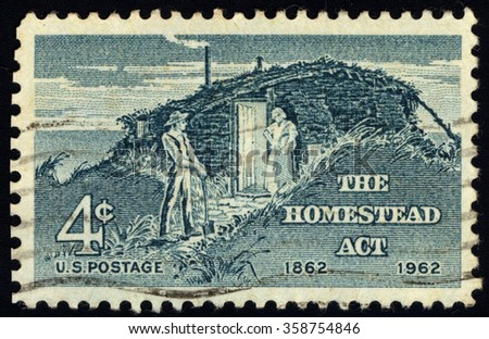 USA - CIRCA 1962 : A stamp printed in USA dedicated to Centenary of Homestead Act shows Sod Hut and Settlers, circa 1962 - stock photo
