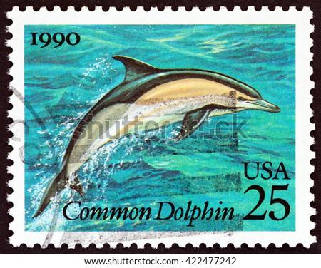 "USA - CIRCA 1990: A stamp printed in USA from the ""Marine Mammals "" issue shows  Common Dolphin (Delphinus delphis), circa 1990. - stock photo"