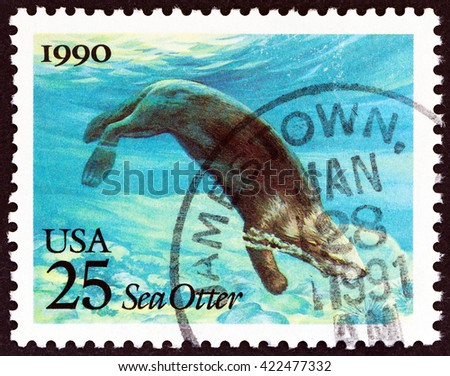 """USA - CIRCA 1990: A stamp printed in USA from the """"Marine Mammals """" issue shows Sea Otter (Enhydra lutris), circa 1990. - stock photo"""