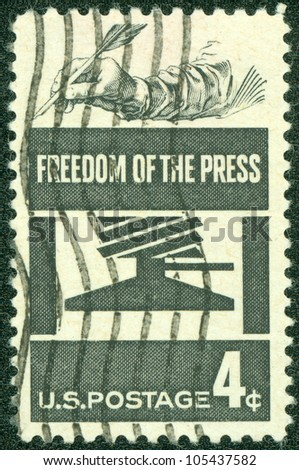 USA - CIRCA 1958: A stamp printed in USA shows the Early Press and Hand Holding Quill, Freedom of the Press Issue, circa 1958 - stock photo