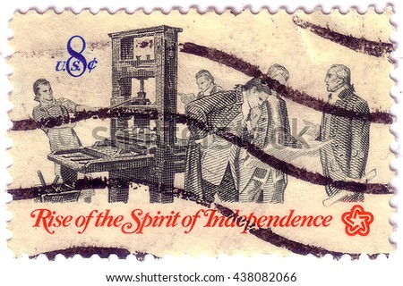 "USA - CIRCA 1973: A Stamp printed in USA shows the Printer and Patriots examining Pamphlet, from the series ""Rise of the Spirit of Independence"", circa 1973 - stock photo"