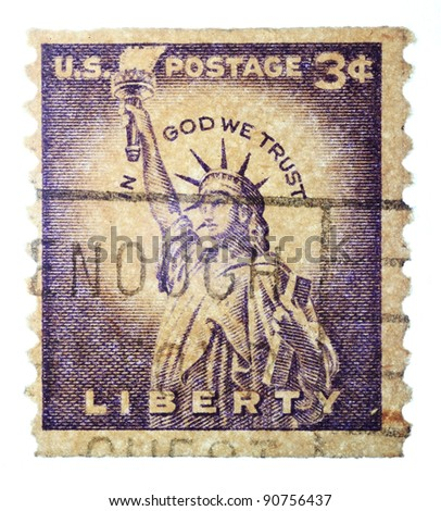 "USA - CIRCA-1953:  A stamp printed in USA shows the stature of the liberty with the words ""IN GOD WE TRUST"" printed around the top of the lady, circa 1953"