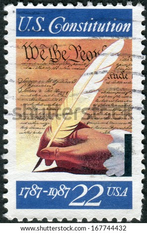 USA - CIRCA 1987: Postage stamp printed in the USA, dedicated to the 200th anniversary of the signing of the U.S. Constitution, shows hand, quill pen and the text of the Constitution, circa 1987 - stock photo