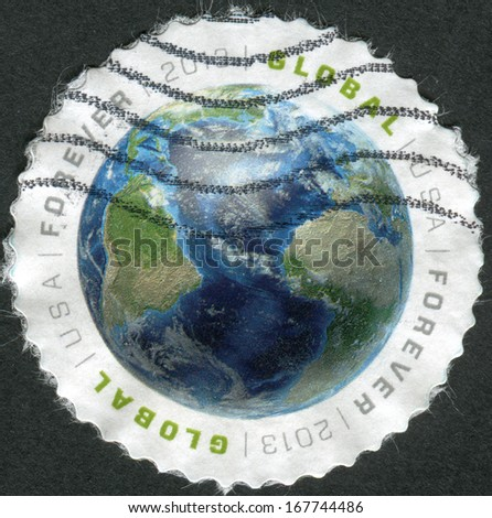 USA - CIRCA 2013: Postage stamp printed in the USA, shows Earth and Atlantic Ocean, North and South America, circa 2013 - stock photo