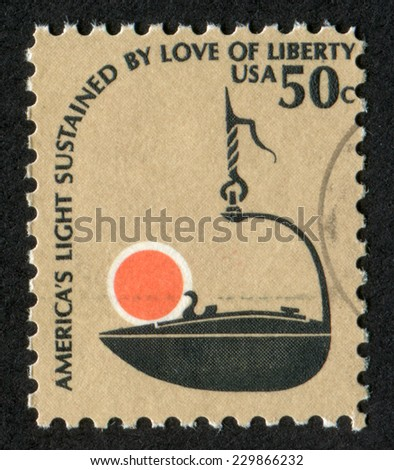 USA- CIRCA 1975,: Postage stamp printed in United States of America an Iron �Betty� Lamp, 17th-18th Cent. Scott Catalog A1007 1608 50c, circa 1975, - stock photo