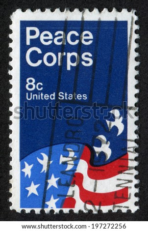 USA- CIRCA 1971: Postage stamp printed in United States of America shows Peace Corps Poster, by David Battle. Scott Catalog A861 1447 8c blue red, circa 1971  - stock photo