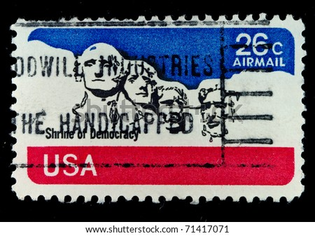 USA - CIRCA 1980's: A post stamp printed in USA shows national memorial . Stone Sculptures of George Washington, Thomas Jefferson, Theodore Roosevelt, and Abraham Lincoln, circa 1980's - stock photo