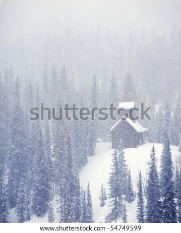 USA, Colorado, Abandoned Silver mine in Snow Storm - stock photo