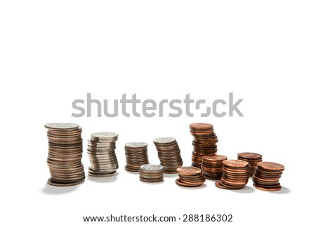 USA currency coins are arranged in stacks of quarters, dimes, nickels and pennies for use as budgeting or financial concepts. - stock photo