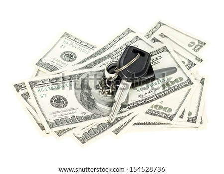 USA dollars with car key isolated on white background - stock photo