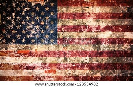 USA flag on a peeling paint brick wall - stock photo