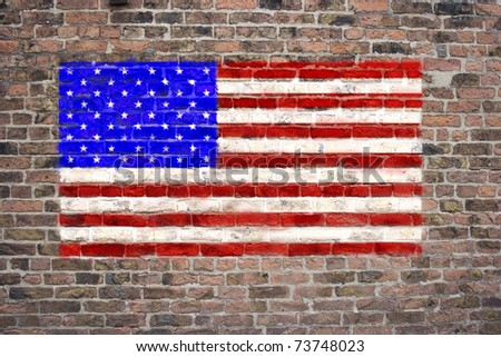 USA flag sprayed on brick wall