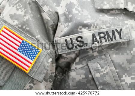 USA flag U.S. ARMY patch on military uniform - studio shot - stock photo