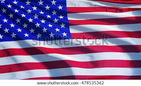 USA flag waving against clean blue sky, close up, isolated with clipping path mask alpha channel transparency