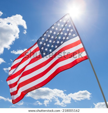 USA flag waving on blue sky background - 1 to 1 ratio - stock photo