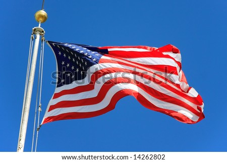 USA flag waving over a blue sky in Battery Park - New York City, USA