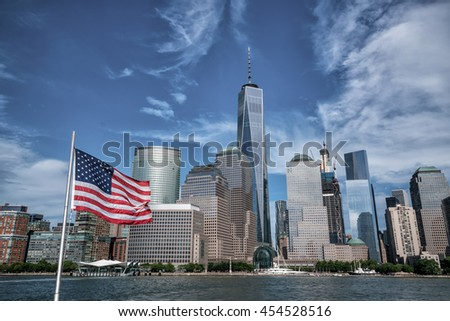 USA flag with Manhattan skyline from Hudson River - stock photo