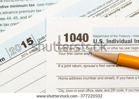 USA IRS tax form 1040 for year 2015 with pencil and taken from above - stock photo
