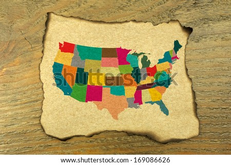 USA map on burnt paper  - stock photo