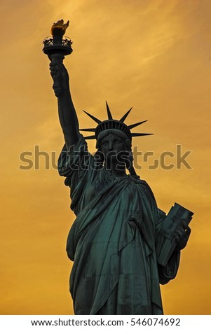 USA, New York State, New York City, Statue of Liberty at sunset