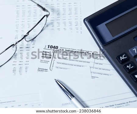 USA 1040 Tax Form with glasses - stock photo