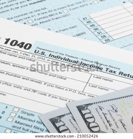 USA 1040 Tax Form with two 100 US dollar bills - stock photo