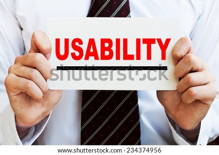 Usability concept in male hands - stock photo