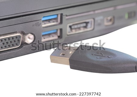 USB cable connector disconnect from laptop usb port - stock photo