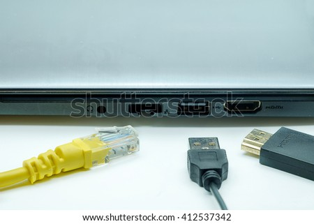 USB cable, LAN cable and HDMI ready connect to laptop on white background. - stock photo