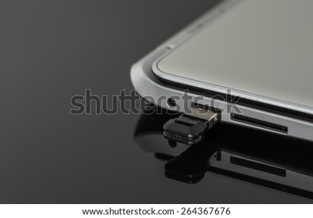 Usb flash drive connected to laptop. - stock photo