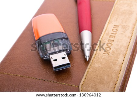 USB Flash Drive, pen and notebook close up - stock photo