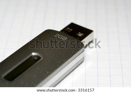USB flash memory on the gray background - stock photo